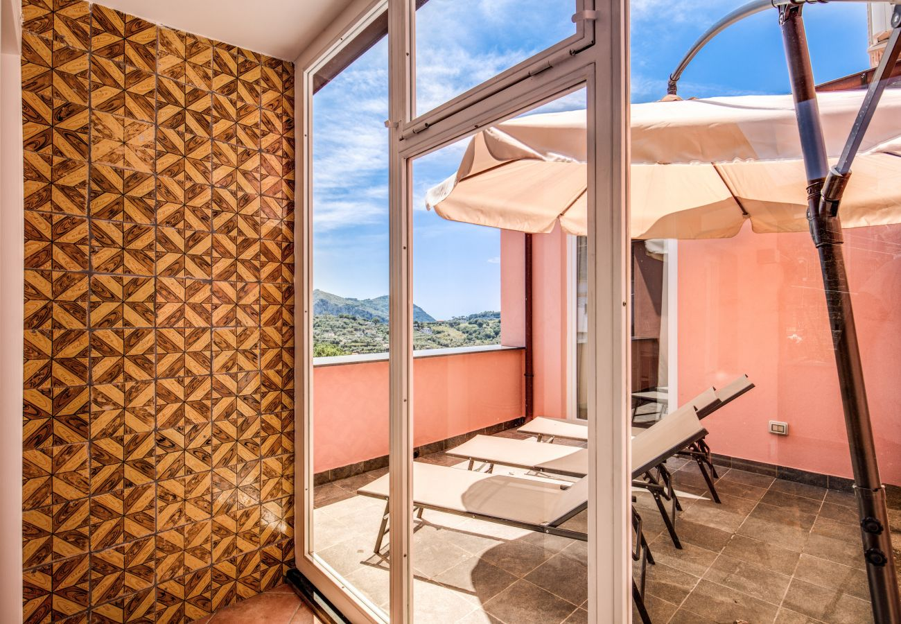 furnished terrace with sunbeds and sun umbrella