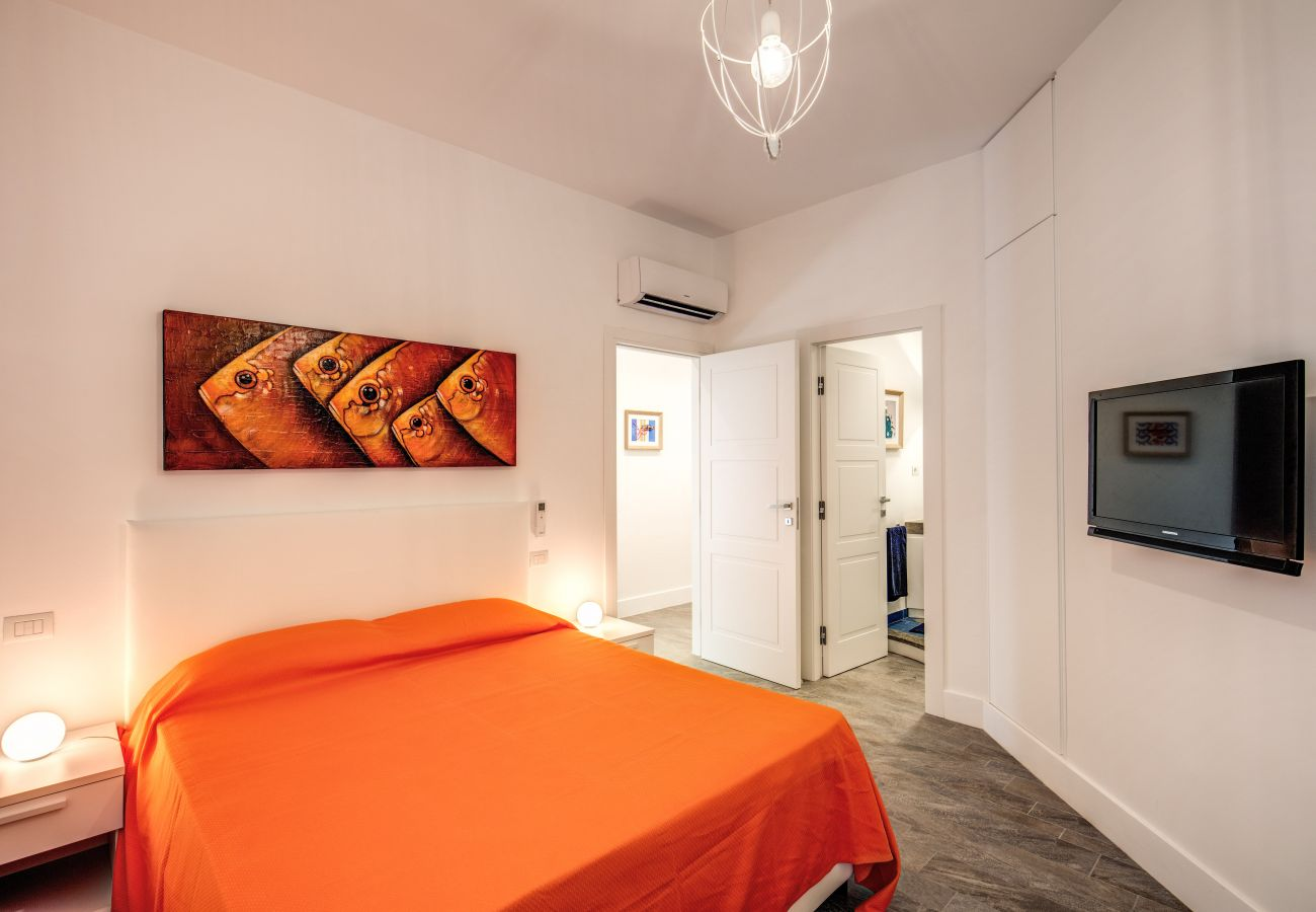 double bedroom, in orange, with tv and air conditioning, sofia apt.